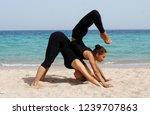girls practice acro yoga in... | Shutterstock . vector #1239707863