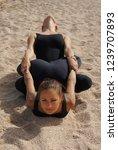 girls practice acro yoga in... | Shutterstock . vector #1239707893