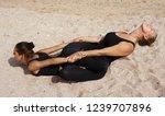 girls practice acro yoga in... | Shutterstock . vector #1239707896