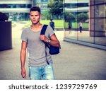 handsome young man walking in... | Shutterstock . vector #1239729769