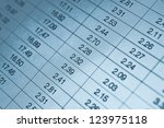 Numbers in table displayed on the computer monitor - stock photo