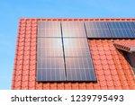 solar panels on a red tiled... | Shutterstock . vector #1239795493