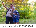 young couple walking in the... | Shutterstock . vector #1239803869