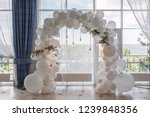 an arch of white balloons .... | Shutterstock . vector #1239848356