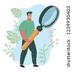 happy man it expert holding in... | Shutterstock .eps vector #1239930403