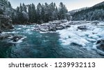 mountain river in winter.... | Shutterstock . vector #1239932113
