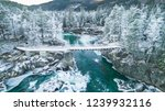 mountain river in winter.... | Shutterstock . vector #1239932116