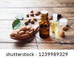 almond oil in bottle on wooden... | Shutterstock . vector #1239989329
