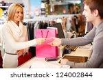portrait of pretty woman giving ... | Shutterstock . vector #124002844