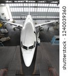 Small photo of Airplane inside aerospace hangar ready for repair and overhaul