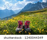 hiking boots and mountains... | Shutterstock . vector #1240044349