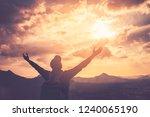 backpacker man raise hand up on ... | Shutterstock . vector #1240065190