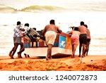 a group of fishermen in kerala...   Shutterstock . vector #1240072873