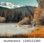 young amateur angler fishing in ... | Shutterstock . vector #1240121383