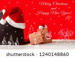 laptop and gifts on the table... | Shutterstock . vector #1240148860