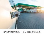 car with money in tank gas... | Shutterstock . vector #1240169116