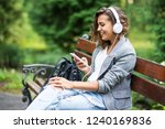 young woman sitting on bench... | Shutterstock . vector #1240169836