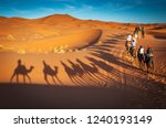 Small photo of camels trekking guided safari tours in Merzouga Morocco Sahara desert camel tour with berber guide Dubai Oman Bahrain Kuwait riding camel shadows