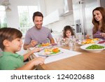 family smiling around a good... | Shutterstock . vector #124020688