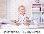 baby girl sitting on white... | Shutterstock . vector #1240238986