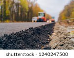 laying a new asphalt on the... | Shutterstock . vector #1240247500