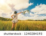 young beautiful woman on green... | Shutterstock . vector #1240284193