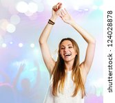 Young attractive woman dancing to the beat with disco background. - stock photo