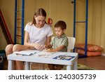 mother and son draw at a table... | Shutterstock . vector #1240305739
