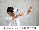 male doctor wearing virtual... | Shutterstock . vector #1240323730