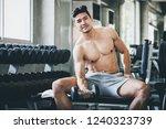 fitness asian man doing... | Shutterstock . vector #1240323739