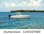 motorboat or boat at anchor in... | Shutterstock . vector #1240329580