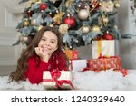 little child girl likes xmas... | Shutterstock . vector #1240329640