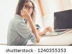 young woman sitting at office... | Shutterstock . vector #1240355353
