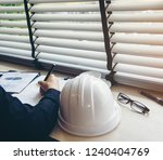 architect and businessman... | Shutterstock . vector #1240404769