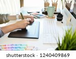 graphic designer working on... | Shutterstock . vector #1240409869