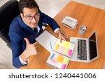 young handsome employee...   Shutterstock . vector #1240441006