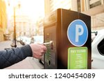 man is paying his parking using ... | Shutterstock . vector #1240454089