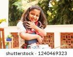 cute indian little girl holding ... | Shutterstock . vector #1240469323