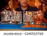 a red cocktail being poured... | Shutterstock . vector #1240515760