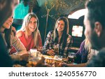 group of happy friends drinking ... | Shutterstock . vector #1240556770