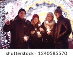 youth celebrating the new year  ... | Shutterstock . vector #1240585570