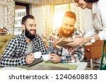 two bearded men are sitting in...   Shutterstock . vector #1240608853