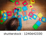 little girl playing with puzzle ... | Shutterstock . vector #1240642330