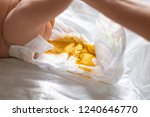 mother changing diapers of... | Shutterstock . vector #1240646770