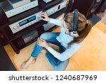 woman with headphones listening ... | Shutterstock . vector #1240687969