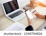 busineess women holding phone... | Shutterstock . vector #1240704826