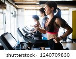 young people running on a... | Shutterstock . vector #1240709830