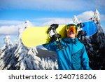 smiling snowboarder posing... | Shutterstock . vector #1240718206