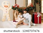 christmas portrait of young... | Shutterstock . vector #1240737676