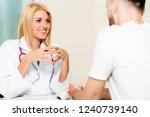 woman doctor is talking to male ...   Shutterstock . vector #1240739140